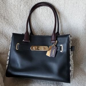 Coach satchel with snake embossed detail